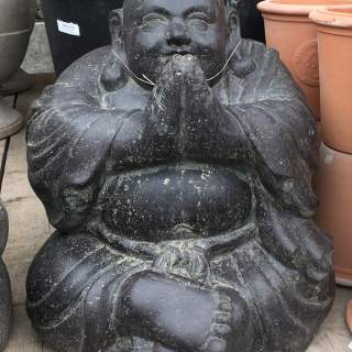Sitting monk, laughing